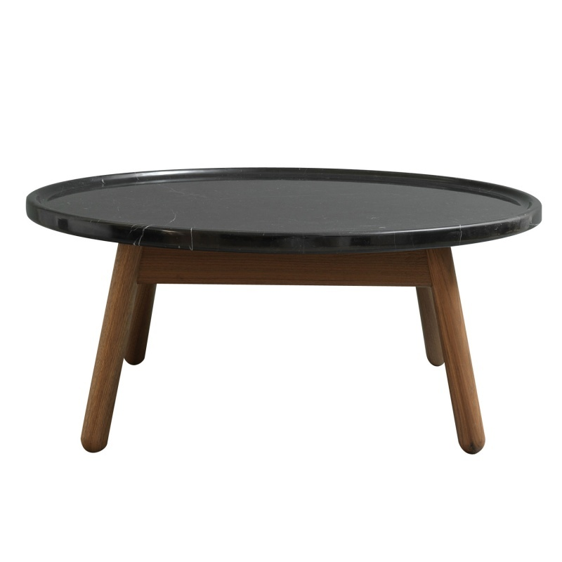 Carve coffee table round walnut base black marble top by bethan gray Stone top coffee table