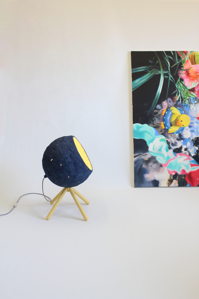 Pluto floor lamp with a picture of Jesus Angel Bordetas in the background